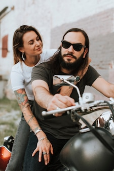 Portrait of a cool biker couple