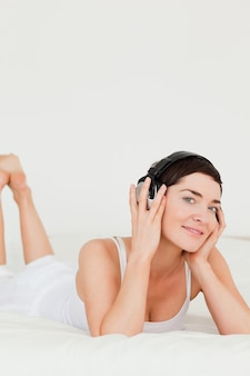 Portrait of a cute brunette listening to music
