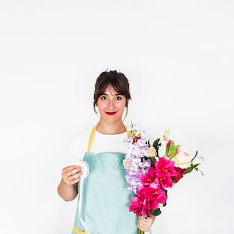 Portrait of a female florist with ribbon and bunch of flowers