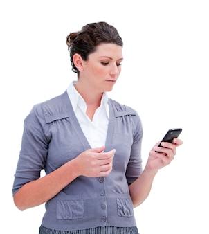 Portrait of a jolly businesswoman sending a text
