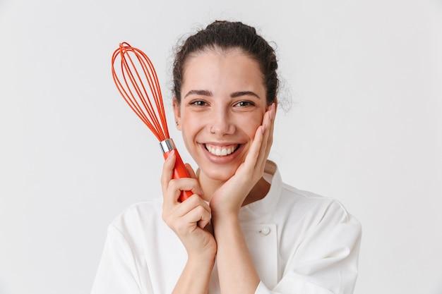 台所用品を持つ素敵な若い女性の肖像画
