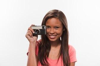 Portrait of a pretty teenage girl holding camera