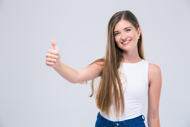 分離された親指を現して笑顔の女性 10 代の肖像画
