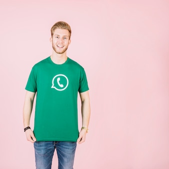Portrait of a smiling man in green whatsapp t-shirt