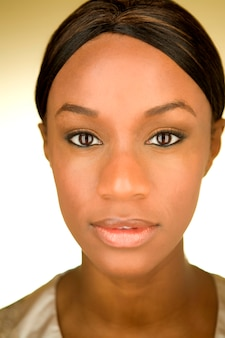 Portrait of a young African American woman staring at the camera