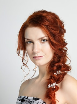 Portrait of a young beautiful red haired caucasian woman.