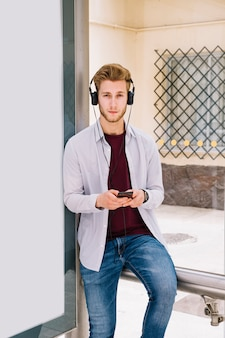 Portrait of a young man listening music