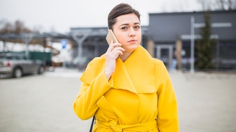 Portrait of a young woman talking on smartphone