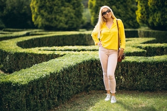 Portrait of beautiful blonde girl outside in park