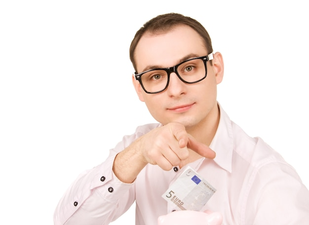 貯金箱とお金を持ったビジネスマンの肖像画
