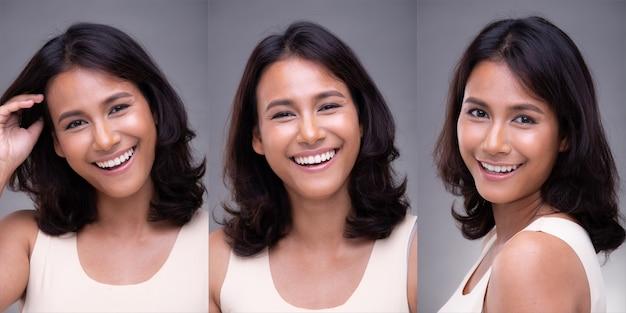 패션 20대 아시아 여성의 초상화는 아름다운 얼굴을 가지고 있고, 그녀는 흰색 셔츠를 입고, 고립된 회색 배경 위에 하얀 치아로 행복한 느낌을 미소 짓습니다.