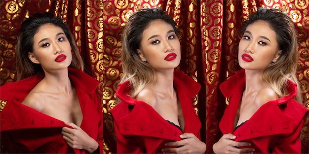 패션 20대 아시아 여성의 초상화에는 브러시와 컬러 립스틱에 아름다운 업데이트 메이크업 아티스트가 있으며, 그녀는 레드 골드 배경 위에 세련된 레드 재킷을 입습니다.