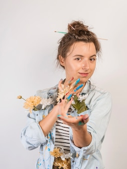 Portrait of female artist with paint on hands