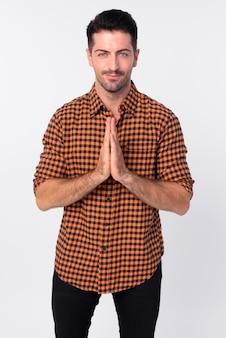 敬意を表して挨拶を一緒に手でハンサムなひげを生やした流行に敏感な男の肖像画
