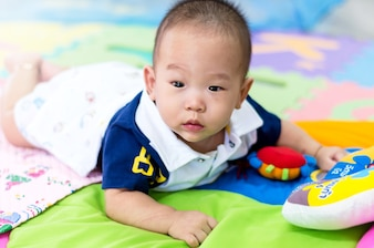 Portrait of happy asian baby on the bed