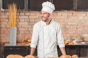 Portrait of happy male baker in uniform