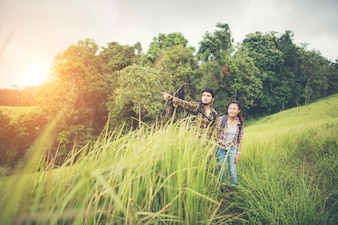 Portrait of happy young couple walking having fun on their hiking trip. Couple concept.