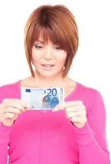 現金のお金を持つ素敵な女性の肖像画