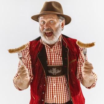 伝統的なバイエルンの服を着て、オクトーバーフェストの男の肖像画