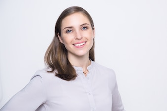 Portrait of positive young woman wearing blouse