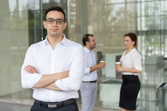 Portrait of serious young Caucasian executive wearing eyeglasses