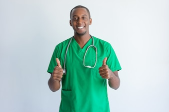 Portrait of successful young doctor showing thumbs up.