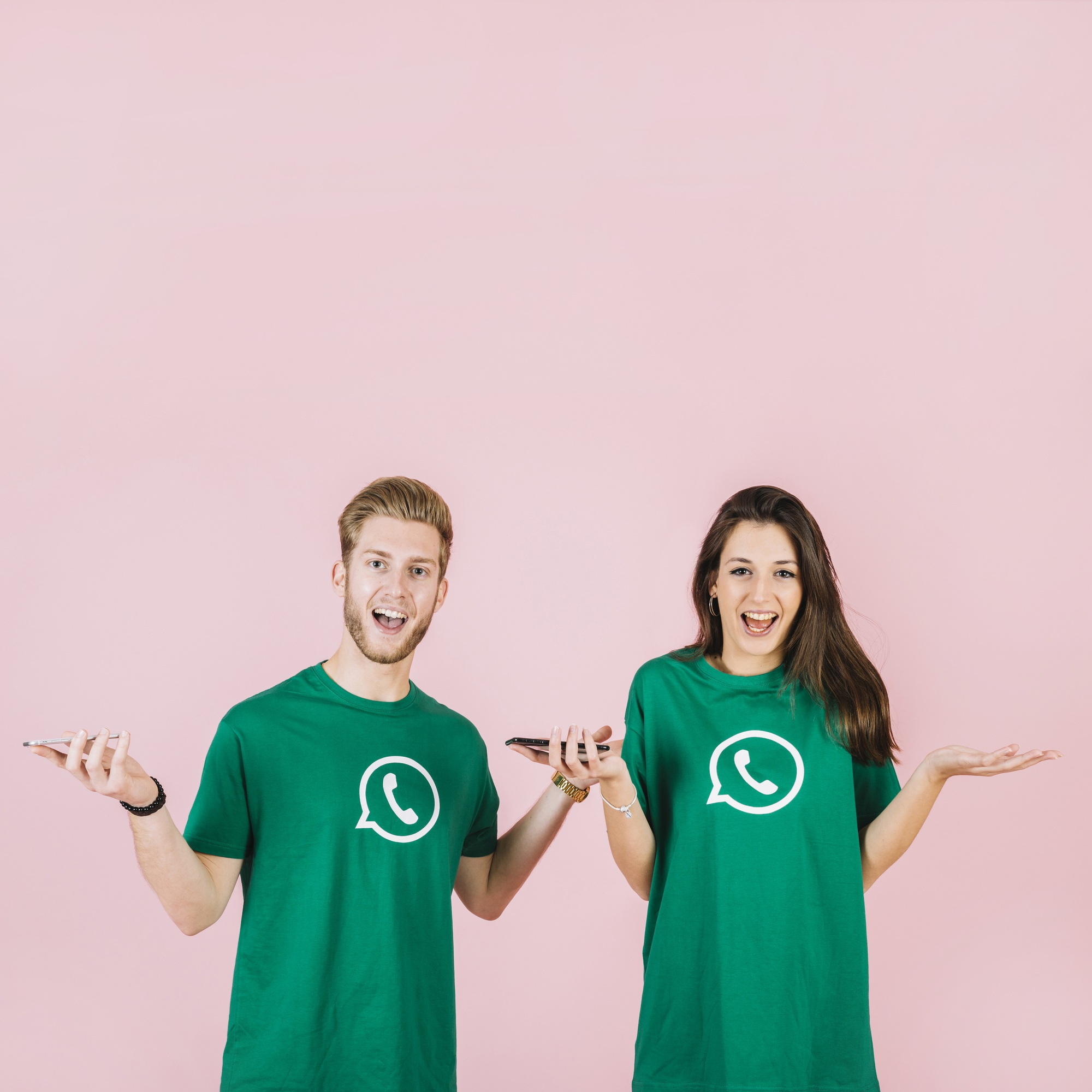 Portrait of surprised young man and woman with smartphone