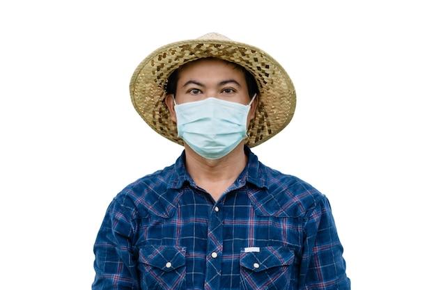 分離された防護マスクを身に着けているタイの農家の肖像画。