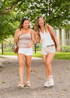 Portrait of two female tourist in shorts enjoying the trip