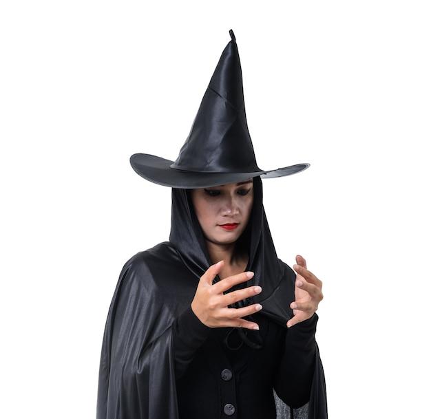 黒の女性の肖像画怖い魔女ハロウィーンの衣装立っている帽子と孤立