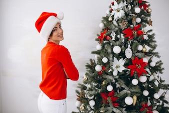 Portrait of woman in santa hat on Christmas