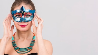 Portrait of woman with carnival mask