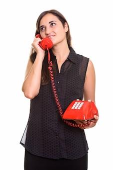 오래 된 전화를 사용 하여 젊은 아름 다운 여자의 초상화