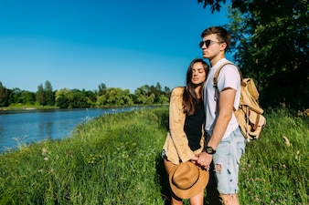 Portrait of young couple standing near the lake