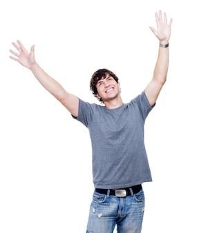 手を上に持ち上げて若い幸せな男の肖像画