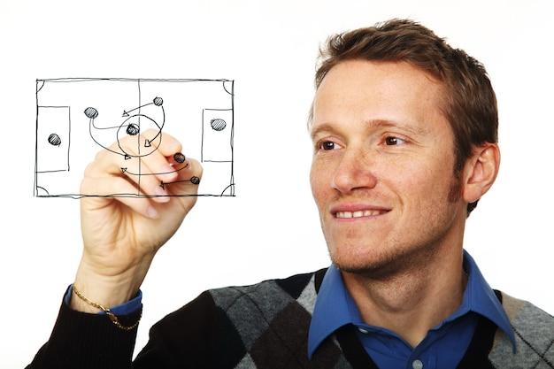 白で隔離のガラス板に書く若い男の肖像画