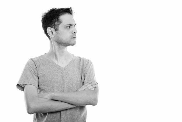 黒と白で白に分離された若い細い男の肖像画