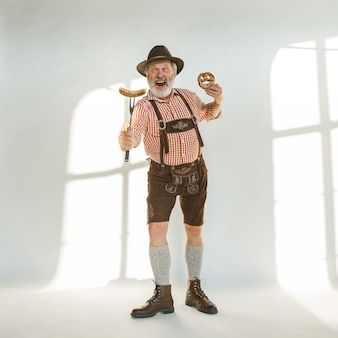 Portrait of oktoberfest man wearing the traditional bavarian clothes