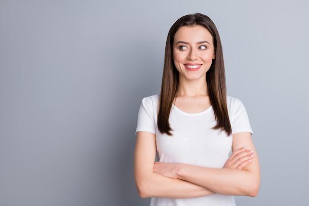Portrait of optimistic content girl cross hands look empty space