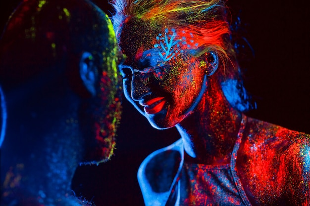 Portrait of a pair of lovers painted in fluorescent powder.