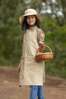 Portrait of a peasant girl walking in the field