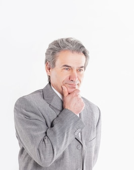 Portrait of pensive businessman on white background.photo with copy space.
