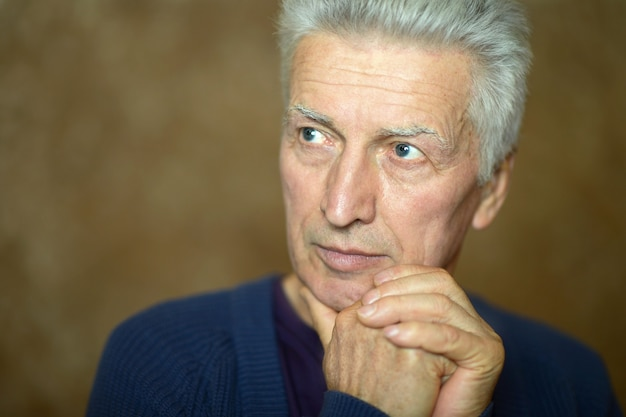 Portrait of a pensive elderly man at home