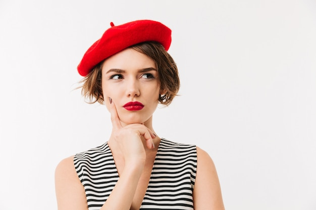 Portrait of a pensive woman dressed in red beret