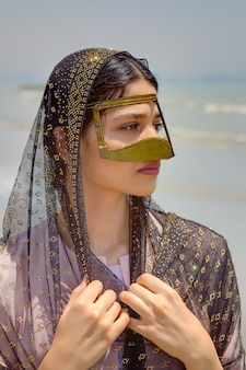 Portrait of persian girl in traditional muslim mask of iran.