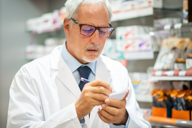 Portrait of a pharmacist at work in his shop