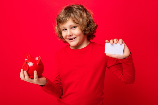 Portrait photo of positive happy smiling little boy with curly blond hair with sincere emotions