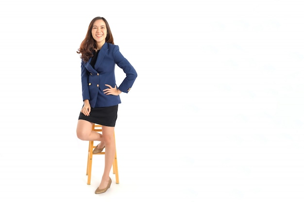 Portrait photo of young beautiful asian woman in formal suit on white background studio shot.