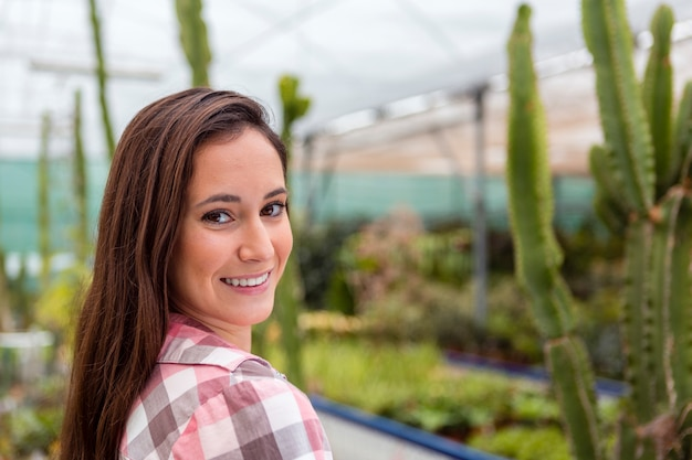 Portrait of photogenic woman in greenhouse