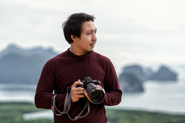 Portrait of photographer or the tourist over the fantastic landscape of samed nang chee view point